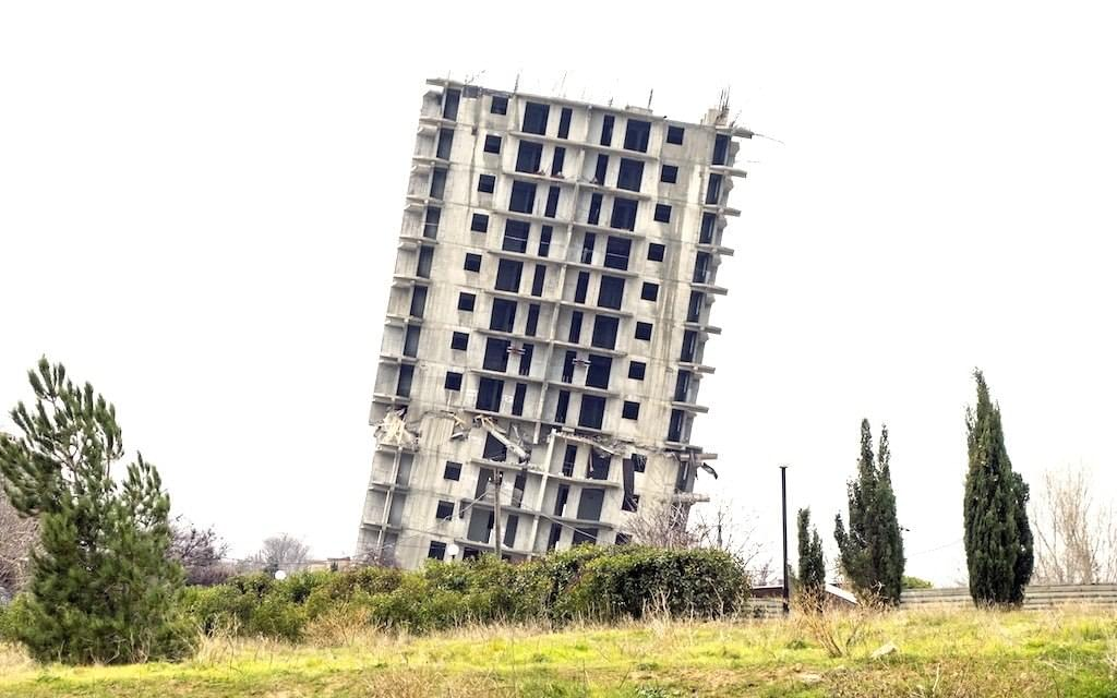Collapsing tower
